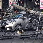 Look: Electrical Post Collapse, Hits Honda Jazz Hood In Quezon City