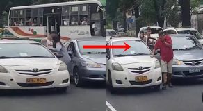 Female Motorist Slaps Old Taxi Driver During Road Rage