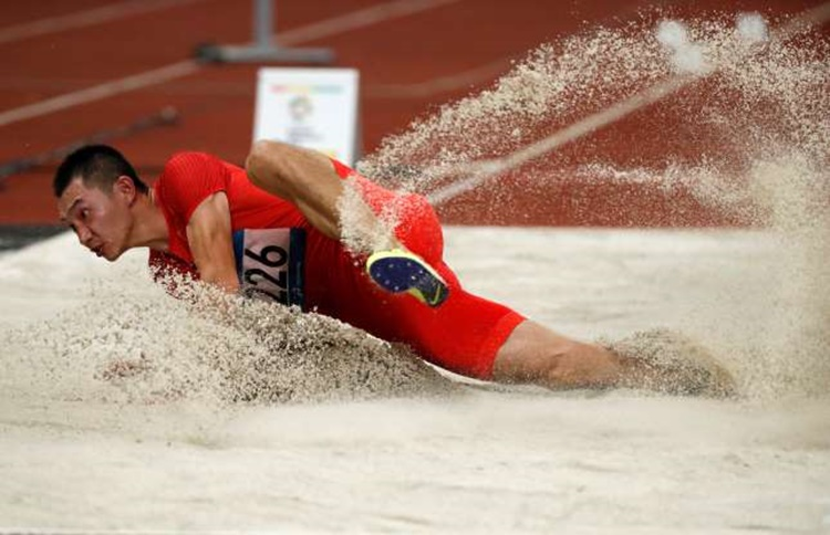 China's Zhang Yaoguang in Men's Long Jump