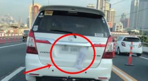 SUV Covers Plate Number with Temporary Plate To Avoid Number Coding