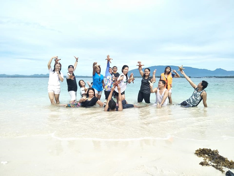 Image result for deped teachers in Balabac throwing starfish