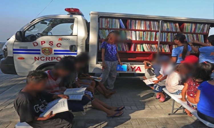 Police Officers on mobile library