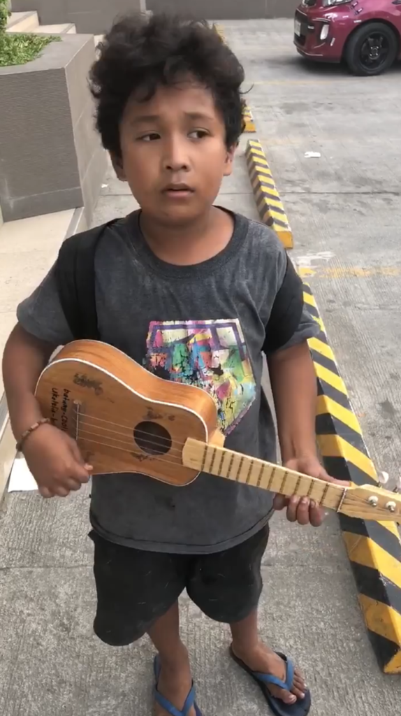 Young Boy Skillfully Plays Ukelele To Earn Money For Family