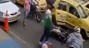 VIDEO: Motorcycle Rider Got Hit By Cab Door, Slams The Wrong Person