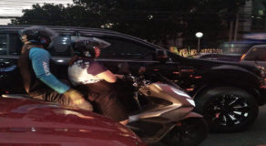 Photo of Angkas Rider Riding at the Back of Passenger Instead of Driving