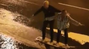 VIDEO: Elderly Couple Use Ironing Board To 'Surf' During Storm