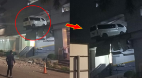 Van Hangs Out from 2nd-level of Parking Area in a Building in Cebu