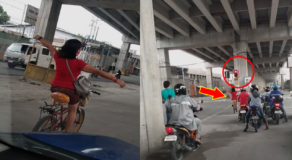 Woman Cycling No-Handed Elicit Reactions for Crossing on Red Traffic Light
