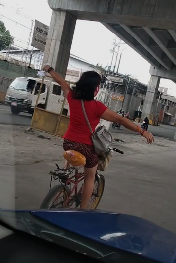 Woman Cycling No-Handed